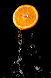 Orange part and waterdrops Stock Image