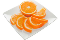 Orange parts on a square plate. Isolated on a white background Stock Photography
