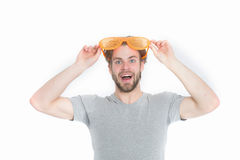 Orange party glasses on funny young man in casual shirt. Isolated on white background Royalty Free Stock Image