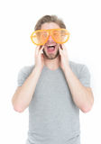 Orange party glasses on funny young man in casual shirt. Isolated on white background Royalty Free Stock Photos