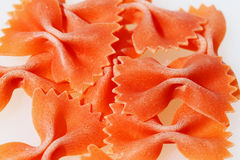 Orange pasta bows. Against a white background stock image