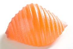 Orange pasta shell. On white Stock Photos