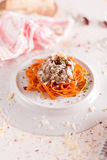 Orange pasta and white sauce served on white plate Stock Photos