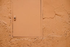 Orange pastel color painted hatch and wall Stock Photos
