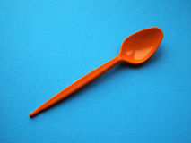 Orange pastic spoon Royalty Free Stock Images