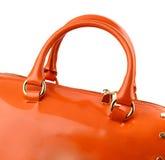 Orange patent handbag isolated on white background. Stock Photo