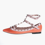 Orange patent leather shoes Stock Images