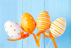 Orange patterned easter eggs on blue background Royalty Free Stock Photo