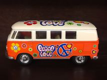Orange PEACE LOVE Van. Up close view of an orange peace love toy Van stock image