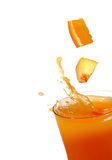 Orange and peach juice. Splash royalty free stock photo