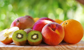 Orange, peach and  kiwis Royalty Free Stock Image