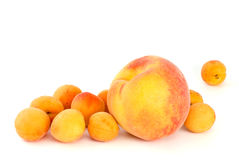 Orange peach and some apricots. Isolated on the white background Royalty Free Stock Photos