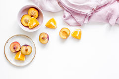Orange and peach summer sweet dessert on white background top view mock-up Royalty Free Stock Photos