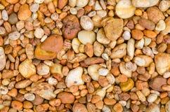 Orange pebble stone texture background. Orange pebble stone on the floor in garden. texture background Royalty Free Stock Image