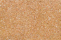 It is Orange pebble wall for pattern and background Stock Photo
