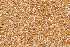 It is Orange pebble wall for pattern and background Stock Photos