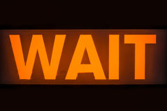 Orange Pedestrian Wait Sign Royalty Free Stock Images