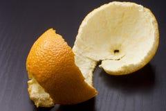 Orange peel. The orange peel on the black top royalty free stock photo