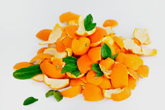 Orange Peel. Peel of ripe oranges mixed with green leaves Stock Photos