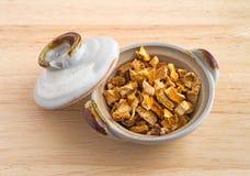 Orange peel chunks in a small dish stock photo