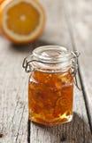 Orange peel jam. Homemade orange peel jam on wood table Stock Images