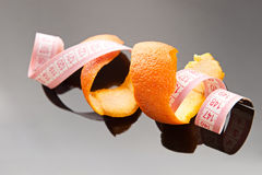 Orange peel and measuring tape Royalty Free Stock Photo