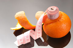 Orange peel and measuring tape Royalty Free Stock Photography