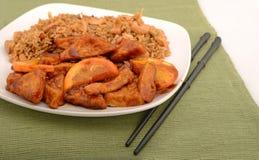 Orange peel tofu and fried rice. Tofu with orange peel sauce on a plate with fried rice at a asian restaurant Royalty Free Stock Images