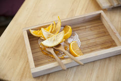 Orange peel on a wooden tray Royalty Free Stock Photo