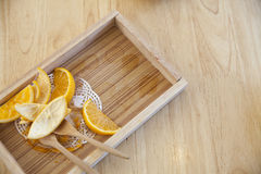 Orange peel on a wooden tray Royalty Free Stock Photography