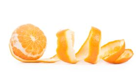Orange peeled skin isolated white background Royalty Free Stock Photos