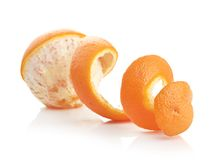 Orange with peeled spiral skin Royalty Free Stock Image