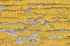 Orange peeling paint on board closeup Stock Photo