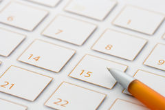 Orange Pen on calendar 1 Royalty Free Stock Image
