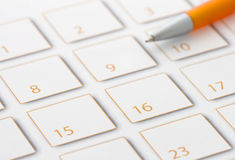 Orange Pen on calendar 2 Stock Photography