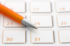 Orange Pen on calendar 3 Royalty Free Stock Photos