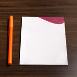 Orange pen and note paper Royalty Free Stock Images