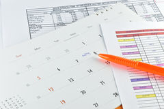 Orange pen placed on meeting plan in calendar. Royalty Free Stock Images