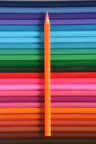 Orange pencil. On multi colored pencil background stock photo