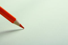 Orange pencil drawing. Orange pencil is drawing on the blank background Stock Photo