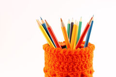 Orange pencil-holders close-up Royalty Free Stock Photo