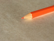 Orange pencil over paper Stock Photography