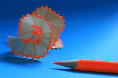 Orange pencil and shaving curl Royalty Free Stock Photography