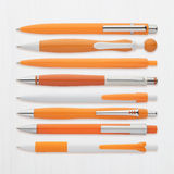 Orange ball pens collection, with PS path Royalty Free Stock Photos