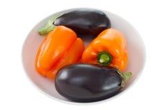 Orange pepper and eggplant Stock Photo