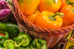 Orange peppers in basket Royalty Free Stock Photography
