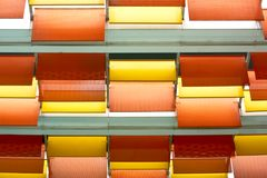 Orange and Yellow Steel Plates Decorated on the Ceiling. Orange Perforated and Yellow Solid Steel Plates Decorated on the Ceiling Stock Photos