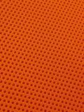 Orange perforierter Gewebe-Beschaffenheits-Muster-Hintergrund Lizenzfreie Stockbilder