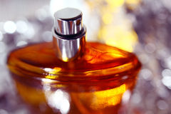 Orange perfume bottle Royalty Free Stock Photos