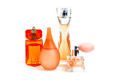 Orange perfume bottles isolated Stock Photography
